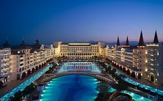 """Hotel Mardan Palace Antalya (Antalya, Turkey) The outdoor pool is more than impressive, with an area of square feet. In the middle of the pool lies a mysterious """"swimming reef"""" with a variety of fish and indigenous species. Hotel Dubai, Armani Hotel, Hotel Pool, Beautiful Pools, Beautiful Places, Amazing Places, Dream Vacations, Vacation Spots, Vacation Travel"""