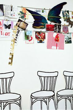 Love this idea of stringing wire and clipping a rotating line of prints, images, objects to it...