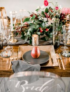 A gold, maroon, crimson, charcoal and black tablescape that exudes old world charm.