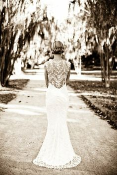 It's all about the back detail. LOVE this wedding dress!