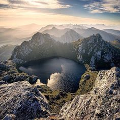 Morning light over the Western Arthur Range, Tasmania, beautifully framed by from the summit of Mount Sirius. In the foreground is the iconic Lake Oberon, shadowed by the jagged outline of Mount Pegasus. Cradle Mountain Tasmania, Places To Travel, Places To See, Places Around The World, Around The Worlds, Tasmania Travel, Argentine, Photos Voyages, Australia Travel