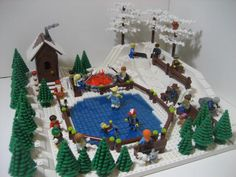 LEGO Christmas Town. This is odd... when I go to mocpages.com pin site it says LEGO Firestar Toys. But when I go there, it says mocpages.com. So I have no idea WHO built it :/