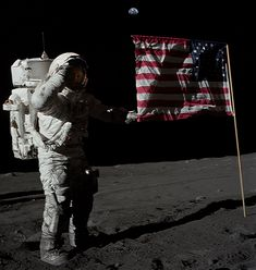 Neil Armstrong salutes the US Flag