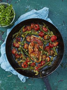 Roasted chicken breast with cherry tomatoes and asparagus