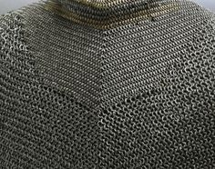 European riveted mail Bishops mantle, detail view of the neck line showing the…