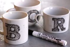 DIY monogram mug... budget friendly.. head out to Goodwill or Dollar store and buy mugs, draw on the guests initial and bake for 35 mins.. cute favors ideas for the bridal party..could add their favorite tea or coffee..