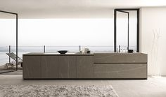 Vertical stone grain juxtaposed with horizontal stone grain. Of coure the horizontal cupboards on the side are not realistic. No real kitchen has 8' horizontal cupboards.  Particolare cucina Twenty
