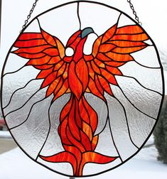 Large Rising Phoenix in brilliant red, yellow and orange surrounded in clear glass to showcase it's beauty. As the showcase and logo piece for my shop, this Phoenix rises above all other pieces. Stained Glass Tattoo, Stained Glass Flowers, Faux Stained Glass, Stained Glass Lamps, Stained Glass Projects, Mosaic Glass, Stained Glass Patterns Free, Stained Glass Designs, Painting On Glass Windows