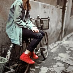 I like the aesthetic of this...oversized, grungy...and then the lovely red nail.