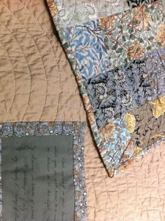 """Detail of Norma's quilt. Wm. Morris """"beautiful"""" quote on label."""