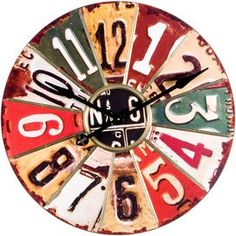"Weathered wall clock with multicolor license plate panels.    Product: ClockConstruction Material: Wood and metalColor: MultiAccommodates: AA batteries - not includedDimensions: 29"" Diameter x 2"" D"