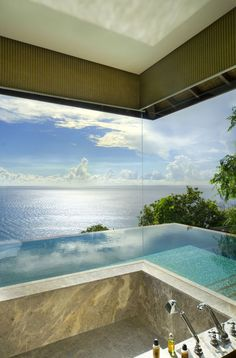 Wow, glass walled bath overlooking an infinity edge pool with a view at the Four Seasons Seychelles. Romantic travel and holiday...