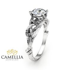 For impeccable style, you simply cannot go wrong with this branch engagement ring from Camellia Jewelry. Hand-forged in stunning detail, the