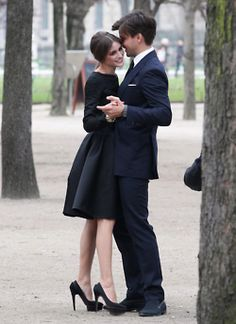 both her ensemble, and mild canoodling in a park-like setting :)