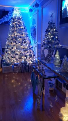 White Christmas tree in blue room