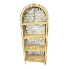 Vintage Boho Chic Bookcase with rounded dome top. Solid wicker with rattan accent. Four shelves at different heights. Piece measures approx 25 1/2 wide x 13 deep x 65 tall. Nice piece with a little age to it. All original and sits flat and flush. Shelves at 5, 20, 35 and 49. Great