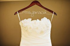 Customized hanger. Good idea to customize hangers with bridesmaids names as a wedding favor too..