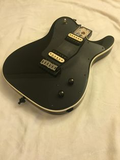 "For your consideration is a customized Fender J5 John 5 Triple Telecaster Deluxe Body aka ""Fender Black Winter Telecaster Deluxe"" Most of the crowd looking for this guitar knows the stock setup, so below I'm just going to list what you will get in this upgraded model. Relocating out of state for ..."