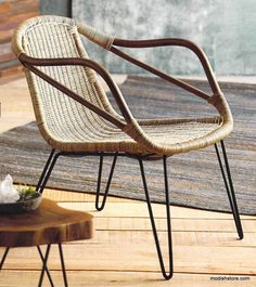 A flea market find inspired our Roost Rapallo Rattan Chair. Pole rattan forms the seat which is filled with tightly woven rattan. Iron, hairpin legs provide sturdy support.