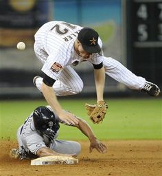 Game #75 6/26/12: Houston Astros' Brian Bixler (12) is upended by San Diego Padres' Will Venable as he slides into second base to break up a double play in the seventh inning of a baseball game Tuesday, June 26, 2012, in Houston. Cameron Maybin was safe at first. (AP Photo/Pat Sullivan)