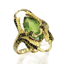 Gold, peridot and enamel ring, René Lalique, circa 1900. Designed as two talons applied with dark green enamel holding a marquise-shaped peridot
