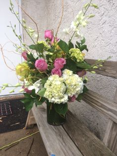 Roses and orchids with mini green hydrangea