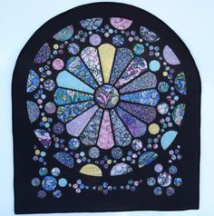 Rose Window quilt. Love how it looks like stained glass.