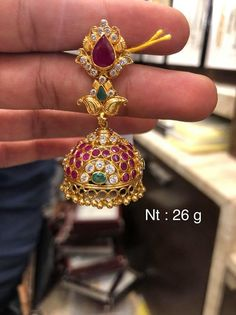 Stunning gold jumkhi studded with rubies and emeralds. Jumkhi with gold ball hangings. Gold Earrings For Women, Gold Bridal Earrings, Gold Wedding Jewelry, Gold Jewelry Simple, Gold Earrings Models, Gold Jhumka Earrings, Chandelier Earrings, Gold Necklace, Ruby Necklace Designs
