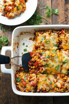 Not sure about the healthy part but certainly sounds yummy.Healthy Mexican Casserole with Roasted Corn and Peppers by pinchofyum: Vegetarian, 230 calories, and naturally gluten free! Vegetarian Comfort Food, Vegetarian Dinners, Healthy Dinner Recipes, Mexican Food Recipes, Healthy Mexican Casserole, Musaka, Best Casseroles, Casserole Recipes, Chicken Casserole