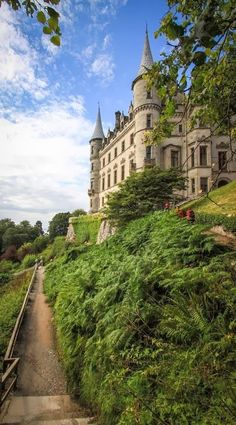 """Dunrobin Castle, Scotland-Dunrobin's origins lie in the Middle Ages, but most of the present building is the work of Sir Charles Barry, the architect of the Palace of Westminster in London, who greatly extended the building in 1845. The resulting house has a """"French Renaissance meets Scots Baronial"""" style. Some of the original building is visible in the interior courtyard. There are 189 rooms within the house, making it the largest house in the northern Highlands."""