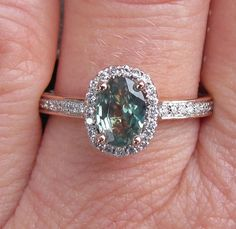 Alexandrite 14k Rose Gold Diamond Halo Engagement Ring Rare Gemstone Engagement Ring. $1,550.00, via Etsy.