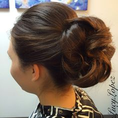 Formal hair by Lucy Lopez Cleveland Ohio. Big full chignon.