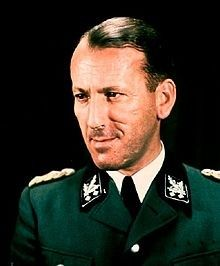 Ernst Kaltenbrunner (4 October 1903 – 16 October 1946) was an Austrian-born senior official of Nazi Germany during World War II. Between January 1943 and May 1945, he held the offices of Chief of the Reichssicherheitshauptamt, President of Interpol and, as a SS-Obergruppenführer und General der Polizei und Waffen-SS, he was the highest-ranking Schutzstaffel (SS) leader to face trial at the first Nuremberg Trials. He was found guilty of war crimes and crimes against humanity and executed.