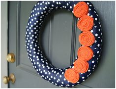 Orange & Navy.  Wrapped Ribbon Wreath with roses.