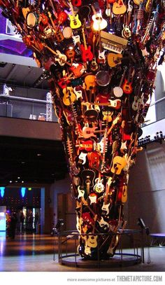 (Seattle) i MUST see this one day! The Guitar Tornado: This sculpture is in the entrance to Paul Allen's Experience Music Project, which is right next to the Space Needle in Seattle. Seattle Washington, Washington State, Sleepless In Seattle, The Meta Picture, Evergreen State, Guitar Art, Oh The Places You'll Go, Pacific Northwest, Street Art