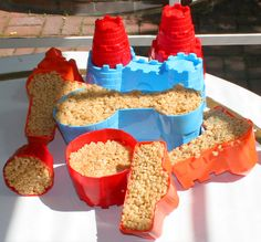 Castle using rice crispy and sand castle molds. This is really fun! Doing this again for Angelina's #ColorBlast birthday party using food coloring to dye the rice crispies. Hopefully all goes well :)