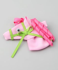 Whimsy and cheer come together on this horse clip, complete with bright pink ringlets. Handmade and carefully crafted with sealed ends to prevent fraying, this happy-go-lucky piece will brighten any 'do.  Note: This bow is oriented differently for either the left or right side of the head.