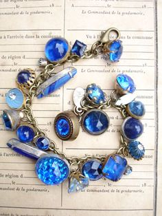 All Blues Vintage Colored Button Bracelet This bracelet has all vintage rhinestone buttons in shades of blue. Each button is different!...