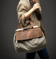 Washed canvas with leather Shoulder Messenger portable leisure bag. $62.98, via Etsy.
