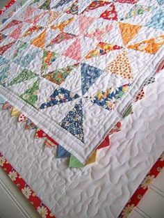 Love this Moda Bake Shop Pinwheel Baby Quilt.  I must try the prarie points borders and I MUUUUUST get ahold of one of those charm packs!