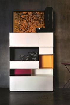 Storage units, made of steel sheet, that can be either open, with drawers or sliding doors. Adhoc stems from the desire to create a home furnishing system with a historically industrial material.