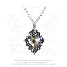 P711  - Crystal Heart Pendant A pure heart of rainbow-spangled white crystal is set inside a simple foliate frame of Victorian sentiment.