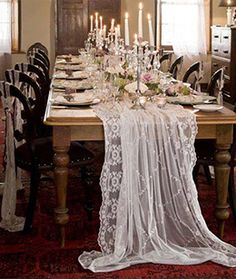 For DIY'ers an old lace curtain panel would accomplish this look too.