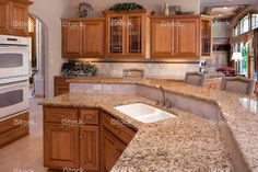Custom Luxury Eat-In Kitchen With Granite Counters, Oak Cabinets; Kitchen update with oak cabinets and white appliances. Eat In Kitchen, Updated Kitchen, Kitchen Redo, Kitchen Ideas, Kitchen Inspiration, Outdoor Kitchen Countertops, Kitchen Backsplash, Granite Counters, Kitchens