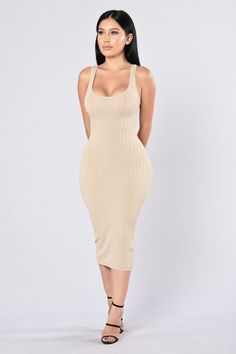 - Available in Taupe and Olive - Knit Dress - Ribbed - Sleeveless - Round Neckline - Midi Length - Fitted - 70% Rayon 30% Nylon