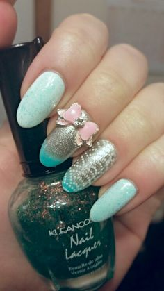 #MintGreen #HimeNails, done using a #KleanKolor (topper) in: Chunky Holo Teal . Also: #OPI: Alpine Snow, #OPI: Radiance, and a #Konad: White stamping design. Pink bows from #bornprettystory.com