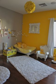 Golden yellow, gray, and white scheme with pint sized baroque furniture and shaggy rug
