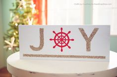 DIY Nautical Christmas Sign.  Would like it with an oar underlining it!