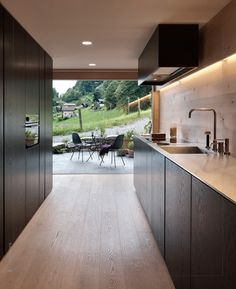This kitchen has a thin but large slide out which can transform it into an outdoor space. Epic look likes it is in Europe but would be great in a northern California setting.