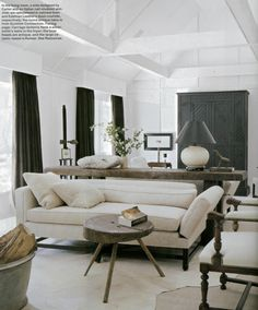 .ceiling with white beams on pitch room - the beams don't feel heavy int his light color. Airy and spacious